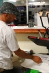 Owner Donte Bailey creating custom vinyl for a T-Shirt
